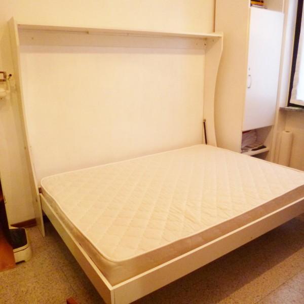 foto del letto a parete una piazza e mezza, aperto
